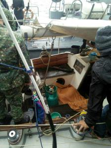 "In this photo provided by Armed Forces of the Philippines Western Mindanao Command (WESMINCOM) and authorized for distribution by Army Maj. Filemon Tan Jr. Monday, Nov. 7, 2016, Philippine Navy crew board a yacht named ""Rockall"" after being found abandoned off the Sulu Sea in southern Philippines over the weekend. The Philippine military is verifying a claim by Abu Sayyaf militants that they have kidnapped a German man from the yacht and shot and killed his female companion, whose suspected body was found in the abandoned boat in the southern Philippines, military officials said Monday. Regional military spokesman Maj. Filemon Tan said Abu Sayyaf spokesman Muamar Askali had claimed the militants kidnapped Juegen Kantner and killed his companion while the couple were cruising off neighboring Malaysia's Sabah state. (WESMINCOM via AP)"