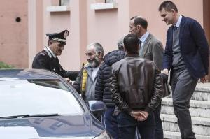 Danilo Calonego, second from left, leaves a police station after being questioned by prosecutor Sergio Colaiocco, in Rome, Saturday, Nov. 5, 2016, after being freed. Calonego and two colleagues had been kidnapped at Gath, Libya, on Sept. 19.  (Giuseppe Lami/ANSA via AP)