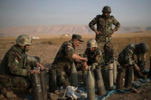 Kurdish Peshmerga prepare to fire artillery at Islamic State positions in Bashiqa, east of Mosul, Iraq, Monday, Nov. 7, 2016. Iraqi Kurdish fighters exchanged heavy fire with IS militants early on Monday as they advanced from two directions on a town held by the Islamic State group east of the city of Mosul. (AP Photo/Felipe Dana)