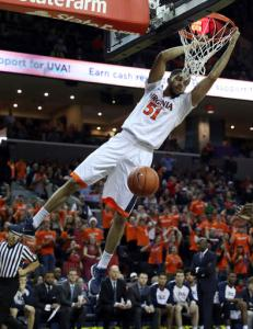 Virginia guard Darius Thompson (51) dunks the ball during an NCAA college basketball game against Yale in Charlottesville, Va., Sunday, Nov. 20, 2016. (Andrew Shurtleff/The Daily Progress via AP)