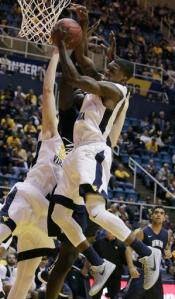 West Virginia guard Teyvon Myers (0) grabs a rebound during the first half of an NCAA college basketball game against New Hampshire, Sunday, Nov. 20, 2016, in Morgantown, W.Va. (AP Photo/Raymond Thompson)