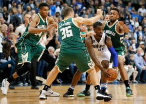 Dallas Mavericks forward Harrison Barnes (40) maneuvers to get out of coverage by Milwaukee Bucks' Giannis Antetokounmpo (34) of Greece, Mirza Teletovic (35) of Bosnia and Herzegovina and Jabari Parker, right rear, in overtime of an NBA basketball game, Sunday, Nov. 6, 2016, in Dallas. (AP Photo/Tony Gutierrez)