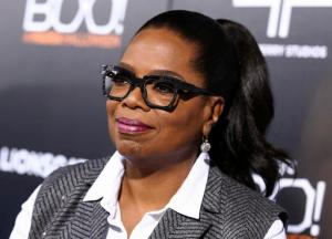 """FILE - In this Oct. 17, 2016 file photo, Oprah Winfrey attends the world premiere of """"BOO! A Madea Halloween"""" in Los Angeles. Winfrey said she was initially in disbelief after she learned Donald Trump was elected president of the United States. Winfrey doesn't think Trump's victory was a repudiation of Obama. She credits his victory to his millions of supporters who felt like their voices had not been heard. Winfrey says she is keeping an """"open mind."""" (Photo by John Salangsang/Invision/AP, File)"""