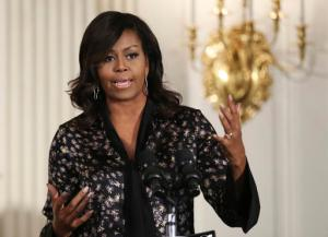 In this Friday, Oct. 21, 2016, file photo, first lady Michelle Obama speaks to student participants during a Grammy Museum musical workshops hosted by the first lady in the East Room of the White House in Washington.  Clay Town, W.Va. Mayor Beverly Whaling resigned her post Tuesday, Nov. 15, following a backlash after she posted a response to a racist comment about the first lady on Facebook. (AP Photo/Manuel Balce Ceneta, File)