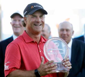 Scott McCarron holds the trophy after winning the Dominion Charity Classic golf tournament Sunday, Nov. 6, 2016, in Richmond, Va. (Alexa Welch Edlund/Richmond Times-Dispatch via AP)