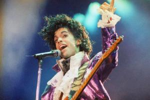 FILE - In this Feb. 18, 1985 file photo, Prince performs at the Forum in Inglewood, Calif. Prince's NPG Records is suing for copyright infringement after it says Jay Z's Tidal music service streamed Prince's songs without permission following the pop icon's death earlier this year. The lawsuit was filed in Minneapolis federal court on Tuesday, Nov. 15, 2016. (AP Photo/Liu Heung Shing, File)