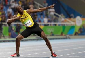 """FILE - In this Aug. 18, 2016, file photo, Usain Bolt, from Jamaica, celebrates winning the gold medal in the men's 200-meter final during the athletics competitions of the 2016 Summer Olympics at the Olympic stadium in Rio de Janeiro, Brazil. Bolt is starring in a new documentary about his path to the Rio Olympics, and the triple-triple, though he stops short of considering himself an actor, for now. The Jamaican star's film """"I Am Bolt"""" is released on Monday, Nov. 28, 2016, showing what he hopes is a more complete picture of how he became a nine-time Olympic champion. (AP Photo/David J. Phillip, File)"""