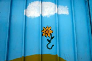 This 22 Oct. 2016 photo, a painted flower is seen on the wall of the Galvarino child care center where a young  girl named Lissette died while in the custody of the state, in Santiago, Chile. Lissette's case exploded in a crisis over the care of at-risk children that has outraged Chileans. After initially reporting just 185 deaths, the government recently acknowledged that 865 children have died under the care of the National Service for Minors over 11 years. (AP Photo/Luis Hidalgo)