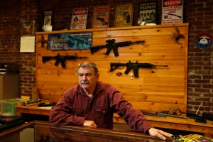 In this Thursday, Oct. 20, 2016 photo, Bob Hagopian works in his gun shop in downtown Madison, Maine. Madison is in the state's 2nd Congressional District, a place where Trump's message is resonating and could win him an electoral vote.(AP Photo/Robert F. Bukaty)