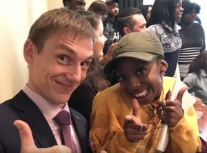A Russian TV news anchor posed with an NSU mass communications major after speaking to NSU students through a translator as part of a Norfolk Sister City program.