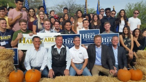 Mitt Romney, Rep. Cresent Hardy, Rep. Joe Heck, Sen. Dean Heller and Nevada Lt. Gov. Mark Hutchison pose for photos with campaign volunteers at a campaign rally in Las Vegas on Saturday, Oct. 8, 2016. All of the Republicans say they can't support Donald Trump. (AP Photo/Michelle Rindels)