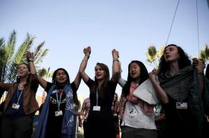 """Environmental activists stage a protest against President-elect Donald Trump at the Climate Conference, known as COP22, in Marrakech, Morocco, Wednesday, Nov. 9, 2016. The election of a U.S. president who has called global warming a """"hoax"""" alarmed environmentalists and climate scientists and raised questions about whether America, once again, would pull out of an international climate deal. (AP Photo/Mosa'ab Elshamy)"""