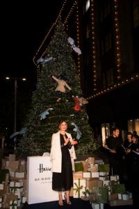 Actress Lily James poses for photographers after turning on the Harrods Christmas lights, in London, Thursday, Nov. 3, 2016. (Photo by Vianney Le Caer/Invision/AP)