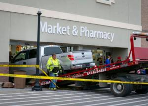 Law enforcement agencies work the scene of a deadly accident at Wal-Mart in Pella, Iowa, on Thursday, Dec. 1, 2016. Authorities said multiple people were killed and others injured when a pickup truck rammed through a front entrance of the store. (Bryon Houlgrave  /The Des Moines Register via AP  )