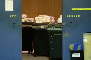 Ballots are stacked up behind a door as a statewide presidential election recount begins Thursday, Dec. 1, 2016, in Milwaukee. The first candidate-driven statewide recount of a presidential election in 16 years began Thursday in Wisconsin, a state that Donald Trump won by less than a percentage point over Hillary Clinton after polls long predicted a Clinton victory. (AP Photo/Morry Gash)