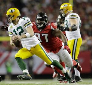 Green Bay Packers' Aaron Rodgers tries to get away from Atlanta Falcons' Grady Jarrett during the second half of the NFL football NFC championship game Sunday, Jan. 22, 2017, in Atlanta. (AP Photo/David Goldman)