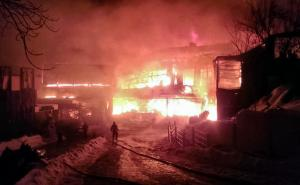 In this image provided by the Romania's General Inspectorate for Emergency Situations (ISU), a firefighter approaches the burning compound after a fire erupted in the early hours at the upmarket Bamboo nightclub, in Bucharest, Romania, Saturday, Jan 21, 2017. Fire engulfed a popular nightclub in the Romanian capital Saturday, sending more than 40 people to hospitals for treatment including one who was seriously injured. No deaths were reported.(ISU via AP)