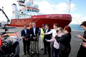 Australian Federal Infrastructure and Transport Minister Darren Chester, third left, holds a press conference, Monday, Jan. 23, 2017, in Perth, Australia, with Malaysian Transport Minister Liow Tiong Lai, left, and other officials in front of the search ship Fugro Equator, one of the vessels involved in the MH370 search. Transport officials from Australia, Malaysia and China met the crew of Fugro Equator, who were ordered to return last week after the countries officially suspended the nearly three-year search for the plane in the Indian Ocean. (Richard Wainwright/AAP Image via AP)