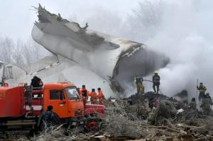 Kyrgyz Emergency Ministry officials work among remains of a crashed Turkish Boeing 747 cargo plane at a residential area outside Bishkek, Kyrgyzstan Monday, Jan. 16, 2017. The cargo plane crashed Monday morning, killing people in the residential area adjacent to the Manas airport as well as those on the plane. (AP Photo/Vladimir Voronin)