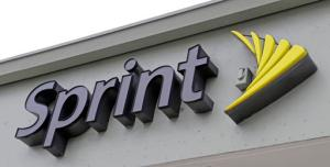 This Friday, Oct. 28, 2016, photo shows a Sprint sign in Miami. Sprint is buying a 33 percent stake in Tidal, the music streaming service owned by artists including Jay-Z, Madonna and Kanye West, the companies announced Monday, Jan. 23, 2017. (AP Photo/Alan Diaz)