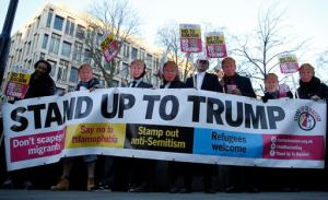 Campaigners demonstrate outside the United States Embassy in London, Friday, Jan. 20, 2017, holding placards and wearing Trump face masks as they protest ahead of the inauguration of Donald Trump as U.S President. (AP Photo/Alastair Grant)