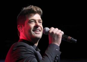Judge restricts Robin Thicke's contact with his son,ex-wife