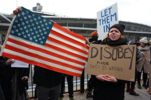 Protesters assemble at John F. Kennedy International Airport in New York, Saturday, Jan. 28, 2017 after two Iraqi refugees were detained while trying to enter the country. On Friday, Jan. 27, President Donald Trump signed an executive order suspending all immigration from countries with terrorism concerns for 90 days. Countries included in the ban are Iraq, Syria, Iran, Sudan, Libya, Somalia and Yemen, which are all Muslim-majority nations. (AP Photo/Craig Ruttle)