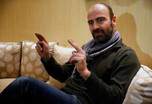 """Kinan Azmeh, 40, a Syrian musician who is one of thousands of valid US green card holders who have found their immigration status in limbo after Trump's order Friday, gives an interview to The Associated Press, in Beirut, Lebanon, Sunday, Jan. 29, 2017. Azmeh, who plays the clarinet, and is currently touring with renowned cellist Yo-Yo Ma, said he is waiting to see whether he will be allowed to return to his New York home in the wake of President Donald Trump's travel ban on seven Muslim-majority nations. Azmeh, said he does not have a """"plan B"""" if he is not allowed back into the United States on his scheduled return Wednesday. (AP Photo/Hussein Malla)"""