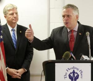 Gov. Terry McAuliffe (D-Va.) announces his criminal justice reform legislative package at a news conference at CARITAS, in Richmond, Va., on Tuesday Jan. 3, 2017. McAuliffe is seeking to restrict penalties regarding loss of driving privileges and also raising dollar amounts for felony charges for theft. At left is Secretary of Public Safety, Brian Moran.    (Joe Mahoney/Richmond Times-Dispatch via AP)