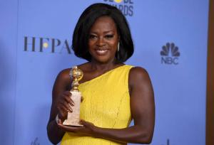 "Viola Davis poses in the press room with the award for best performance by an actress in a supporting role in any motion picture for ""Fences"" at the 74th annual Golden Globe Awards at the Beverly Hilton Hotel on Sunday, Jan. 8, 2017, in Beverly Hills, Calif. (Photo by Jordan Strauss/Invision/AP)"