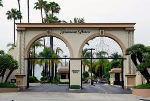 FILE - In this July 8, 2015 file photo, the main gate to Paramount Studios is seen on Melrose Avenue, in Los Angeles. Paramount Pictures said it has inked a co-financing deal with two Chinese companies for the Hollywood studio's slate of movies over the next three years, in a statement released Friday, Jan. 20, 2017. (AP Photo/Nick Ut)