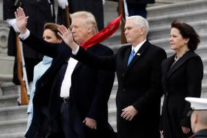 President Donald Trump and first lady Melania Trump along with Vice President Mike Pence and his wife Karen wave to former President Barack Obama during a departure ceremony on the East Front of the U.S. Capitol in Washington, Friday, Jan. 20, 2017, after Trump was inaugurated. (AP Photo/Evan Vucci)