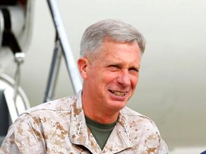 """FILE - In this March 30, 2012 file-pool photo, Marine Gen. Thomas Waldhauser is seen at Camp Pendleton, Calif. Senior U.S. military officials say the massive airstrikes that killed more than 80 Islamic State militants in southern Libya last month generated critical computer data, documents and information from prisoner interrogations that the U.S. can use to track and target more fighters. Waldhauser, the head of U.S. Africa Command, told The Associated Press in an interview Friday, Feb. 17, 2017, that the U.S. got significant intelligence from the camps after the bombings, adding that """"there's some things we're working on.""""  (AP Photo/Mike Blake, Pool, File)"""