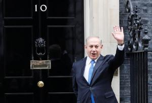 Prime Minister Benjamin Netanyahu of Israel waves to the media as he arrives to meet Britain's Prime Minister Theresa May at Downing Street in London, Monday, Feb. 6, 2017. (AP Photo/Kirsty Wigglesworth)