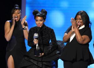 "Taraji P. Henson, from left, Janelle Monae, and Octavia Spencer accept the award for outstanding motion picture for ""Hidden Figures"" at the 48th annual NAACP Image Awards at the Pasadena Civic Auditorium on Saturday, Feb. 11, 2017, in Pasadena, Calif. (Photo by Matt Sayles/Invision/AP)"