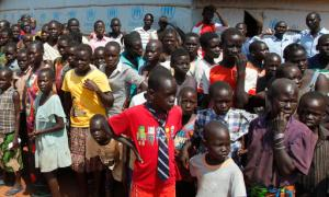 FILE - In this Monday, Aug. 29, 2016 file photo, refugees wait for U.N. High Commissioner for Refugees Filippo Grandi to arrive at a transit center for South Sudanese refugees in the remote northwestern district of Adjumani, near the border with South Sudan, in Uganda. More than 1.5 million South Sudanese have become refugees and their humanitarian needs are overwhelming aid efforts during the country's civil war, according to the United Nations. (AP Photo/Stephen Wandera, File)