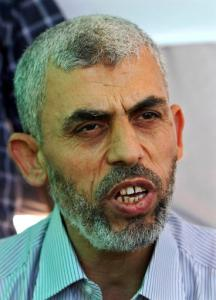 FILE - In this Thursday, Oct. 20, 2011, freed Palestinian prisoner Yehiya Sinwar, a founder of Hamas' military wing, talks during an interview to the Associated Press in Khan Younis, southern Gaza Strip, Thursday, Oct. 20, 2011. A senior Hamas official says the top member of the group's armed wing has been chosen as its new leader in the Gaza Strip. Yehiya Sinwar, the senior commander who was freed by Israel in a 2011 prisoner swap, is considered one of the most hard-line figures in the Islamic militant group. (AP Photo/Adel Hana, File)
