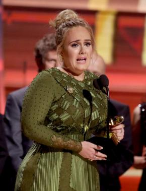 Adele sweeps record, album of year Grammy honors