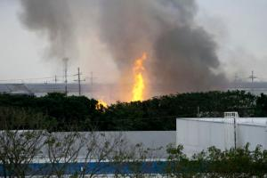 Flames rise from a huge fire at the House Technology Industries (HTI) factory inside the Export Processing Zone Authority for more than twenty hours, Thursday, Feb. 2, 2017 in General Trias township, Cavite province south of Manila, Philippines. The provincial governor says more than 100 workers, including three Japanese, have been injured in a fire that hit a huge factory south of Manila that sent thousands of employees scampering to safety. (AP Photo/Bullit Marquez)