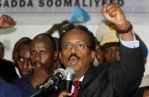 New Somali President Mohamed Abdullahi Farmajo celebrates winning the election and taking office in Mogadishu, Somalia Wednesday, Feb. 8, 2017. Former prime minister Farmajo who holds dual Somali-U.S. citizenship was declared Somalia's new president Wednesday, immediately taking the oath of office as the long-chaotic country moved toward its first fully functioning central government in a quarter-century. (AP Photo/Farah Abdi Warsameh)