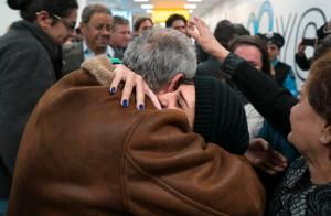 "FILE - In a Monday, Feb. 6, 2017 file photo, family members who have just arrived from Syria embrace and are greeted by family who live in the United States upon their arrival at John F. Kennedy International Airport in New York. Organizers in cities across the U.S. are telling immigrants to miss class, miss work and not shop on Thursday, Feb. 16, 2017,  as a way to show the country how important they are to America's economy and way of life. ""A Day Without Immigrants"" actions are planned in cities including Philadelphia, Washington, Boston and Austin, Texas. (AP Photo/Craig Ruttle)"