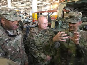 """U.S. Army Lt. Gen. Stephen Townsend, right, talks with officers during a tour north of Baghdad, Iraq, Wednesday, Feb. 8, 2017. Forces fighting the Islamic State group should be able to retake the IS-held cities of Mosul in Iraq and Raqqa in Syria within the next six months, according to the top U.S. commander in Iraq. On a tour north of Baghdad Wednesday, Townsend said """"within the next six months I think we'll see both (the Mosul and Raqqa campaigns) conclude."""" (AP Photo/ Ali Abdul Hassan)"""