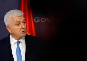 "In this Friday, Feb. 3, 2017 photo, Montenegro's Prime Minister Dusko Markovic speaks during a press conference after talks with his Serbian counterpart Aleksandar Vucic at the Serbia Palace in Belgrade, Serbia. Markovic said Tuesday, Feb. 14, 2017 that those who want to destabilize the country by meddling into its affairs ""should keep their hands off Montenegro."" (AP Photo/Darko Vojinovic)"