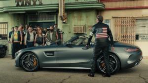 """This photo provided by Mercedes-Benz USA shows an image from the company's """"Easy Driver"""" Super Bowl 51 commercial. To target baby boomers, Mercedes-Benz enlisted the Coen Bros. to direct an update to the tune of Steppenwolf's """"Born to be Wild."""" Bikers at a bar are furious that their bikes have been blocked by a car, until they realize its Peter Fonda driving a Mercedes-Benz AMG Roadster. (Mercedes-Benz USA via AP)"""