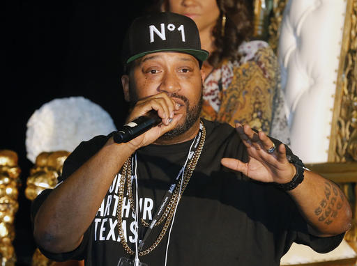 FILE - This March 10, 2014 file photo shows Houston rapper Bun B at a news conference in New Orleans. Bun B launched his New Era H-Town 9FIFTY Snapback Collection at the Lids store in The Galleria in Houston, Thursday, Feb. 2, 2017, during events leading up to the Super Bowl. (AP Photo/Bill Haber, File)