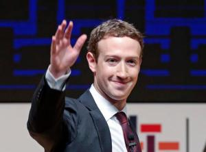 FILE - In this Nov. 19, 2016 file photo, Mark Zuckerberg, chairman and CEO of Facebook, waves at the CEO summit during the annual Asia Pacific Economic Cooperation (APEC) forum in Lima, Peru. Zuckerberg released a missive Thursday, Feb. 16, 2017, outlining his vision for the social network and the world at large. Among other things, Zuckerberg hopes that the social network can encourage more civic engagement, an informed public and community support in the years to come. (AP Photo/Esteban Felix, File)