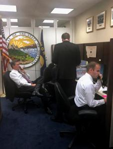 This photo provided by the office of Sen. Steve Daines, R-Mont., taken, Jan. 31, 2017, shows Sen. Daines, left, helping with a surge in constituent telephone calls to his office on Capitol Hill in Washington. A lot of politics is about the basics, and in Congress that means answering the phone. By that measure, life on Capitol Hill in the Trump era is a struggle. Whether constituents are calling to request congressional flags, get help with a local issue — or, more likely, to register their support or displeasure with the latest move by President Donald Trump, these days they are more likely to get a busy signal or voice mail than a live human. (Office of Sen. Steve Daines, R-Mont. via AP)