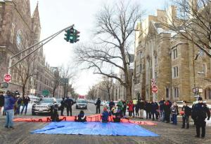 New Haven Police arrested demonstrators who blocked the intersection of Elm and College Streets in New Haven, Conn., Friday, Feb. 10, 2017, and refused to move during a protest and demonstration in favor of changing the name of Yale University's Calhoun College. The peaceful arrests were pre-planned and coordinated between the demonstrators and New Haven Police. (Peter Hvizdak/New Haven Register via AP)
