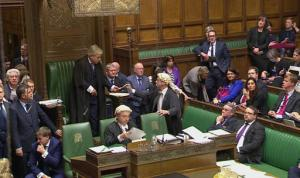 This image taken from Parliamentary Recording Unit TV shows the result of the parliamentary vote in favour of the British Government's Brexit Bill being handed to the Speaker of the House of Commons, Wednesday, Feb. 1, 2017. British lawmakers have backed a bill authorizing the start of European Union exit talks, voting by a decisive 498 to 114 to push the measure past its first major legislative hurdle. (AP Photo/Parliamentary Recording Unit, via AP)