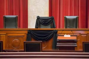"FILE - In this Feb. 16, 2016 file photo, Supreme Court Justice Antonin Scalia's courtroom chair is draped in black to mark his death as part of a tradition that dates to the 19th century, at the Supreme Court in Washington. In the year since Scalia's death last February, the court's empty place has often been referred to as ""Justice Scalia's seat."" But as Supreme Court Justice nominee Neil Gorsuch suggested, the seat's history actually goes back more than 150 years. The lineage includes seven men, all but one nominated to the seat by Republican presidents.  (AP Photo/J. Scott Applewhite, File)"